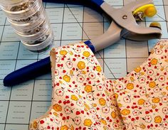 Invisible Snaps Tutorial - she covers ordinary metal prong snaps with fabric - I love this!