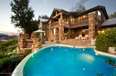 10 Ridge Place - Listing # 128049 - Price: $17,250,000 - Presenting a rare opportunity to own one of the most exclusive, private properties on Red Mountain - offering southern exposure and unobstructed views from Independence Pass to Mt. Sopris. This exquisite property offers breathtaking views from the ample outdoor entertaining areas and an infinity-edged pool with waterfall.