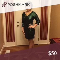 Short Formal Dress The emerald sequins on this dress will make you a show-stopper!! It's a fitted dress, but extremely stretchy for some wiggle room. It is extremely comfortable! I wore it for a winter formal dance, but it could be worn for multiple occasions/events. Only worn twice, so it's in great condition. Paid $140, asking $50 OBO. Express Dresses