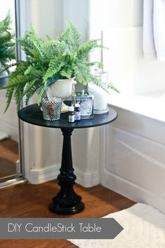DIY Candlestick Table Tutorial from Infarrantly Creative (using a thrifted tall candlestick and a small round tabletop) - clever!