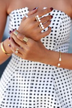 "Those ""pearl knuckles"" make me giggle, but I love the rings on her first finger."