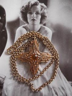 Vintage 1970s Necklace Sarah Coventry Gold by GoodGoodyGirlsJewels, $28.00--I found one like this for $9 in an antique store. MCM feel comes alive against a solid background. Great piece.