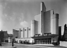 Odeon Cinema, Parsons Hill,  BB87/03661The Woolwich Odeon opened on 25 October 1937. Designed by George Coles, it displays the 'Odeon style' of buff faience tiles and curving horizontals and verticals. The wall bearing the name Odeon hides an integral car park.  Photographer: John Maltby Date Taken: October 1937  © English Heritage