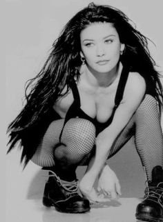 You probably can't wear this outfit without looking like a whore. But Catherine Zeta-Jones can.