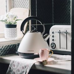 The Accents Traditional Pyramid Kettle & 4 Slice toaster set is a stylish statement for any kitchen, featuring painted stainless steel bodies in white and chrome accents for a modern metallic touch. Add a worthy accent to your interior design with Morphy Richards.