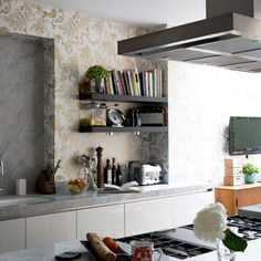 Kitchens: Bright Kitchen with Golden Pattern Wallpaper also Gray Granite Countertop plus Black Wall Shelving and White Kitchen Cabinet