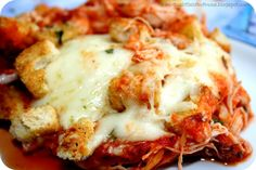 Chicken Parmesan Casserole (This is an excellent basic recipe and I loved it...I cooked some pasta, cooked some chicken breasts with diced onion and garlic, added a can of diced tomatoes with the spaghetti sauce, and lots of Italian seasoning, mixed everything together then put it all in a casserole dish except for the cheese; I layered mozzarella first, then put on fresh shredded parmesan...served it with a salad and garlic bread.  Delicious meal, and will make again.