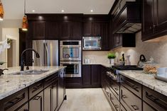 Dark brown kitchen cabinets granite counter tops white for Ak kitchen cabinets calgary