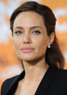 """I haven't had anything done, and I don't think I will. But if it makes somebody happy then that's up to them."" Angelina Jolie on plastic surgery"