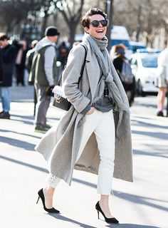 Via:LuckyMagazine How To Wear A Scarf Like A Street Style Star. Wind a pashmina-style scarf once or twice around your neck, letting either end hang in front as usual—but then, tie those trailing ends in a loose knot for extra oomph
