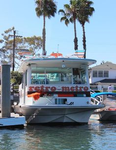 i want to live on a houseboat, especially if it's as cool as this one--check the upper deck!