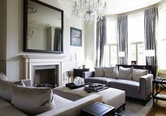 Mastering The Art Of Fireplace Styling, Laurel & Wolf, Large-Wall-Decorating-with-Mirrors-above-Fireplace-for-Living-Room-using-Bay-Windows-and-Crystal-Ceiling-Light-Fixtures