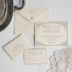 Lady Mary by Lucky Luxe Couture Correspondence. Inspired by Downton Abbey, this post-Edwardian era invitation suite includes lavish flourishing, ivy accents, and  delicate, formal serif typefaces indicative of early 1920s Great Britain.