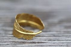 Feather Ring Gold Infusion Bohemian Gold Feather by ArtisanTree, $10.50 In silver, please. And as a bracelet instead of a ring.