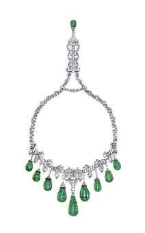 FORMERLY THE PROPERTY OF HRH PRINCESS FAIZA OF EGYPT - AN ART DECO EMERALD AND DIAMOND NECKLACE, BY VAN CLEEF & ARPELS The baguette-cut and epaulet-shaped diamond neckchain enhanced by pavé-set diamond scalopped links, suspending at the front a fringe of nine graduated drop-shaped emeralds with baguette-cut diamond line surmounts, alternated with rectangular-cut diamond collets, to the pendant clasp with drop-shaped emerald terminal, 1929.