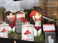 Dessous Danielle storefront in Köln, Germany, showcasing swimwear made with LYCRA® fiber. Take off with LYCRA® fiber!
