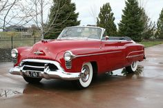 """Make a date with a 'Rocket 8'!""   ""Smooth! 'Rocket' engine and Oldsmobile Hydra-Matic.""                            1950 Oldsmobile 98 DeL..."