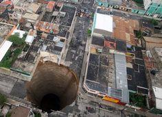 Enormous sinkhole in Guatemala City, Guatemala.