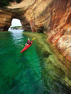 Kayaking along Pictured Rocks National Lakeshore, Upper Peninsula, Michigan. an eight hour day trip along the Pictured Rocks. Breath taking and well worth the money you spend on the experience! I wanna do this! Michigan Vacations, Michigan Travel, Dream Vacations, Vacation Spots, Lake Michigan Beaches, Vacation Places, Italy Vacation, Vacation Ideas, Oh The Places You'll Go
