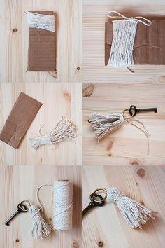 diy key tassels  Supplies      yarn, string or thin leather strips     scissors     piece of cardboard