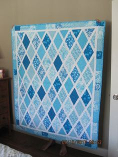 By Teresa Chelli on the Quilting for Beginners Facebook page. Blue diamond quilt.