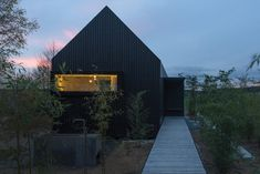 format elf nestles dark barn-shaped houses into bavarian forest Residential Interior Design, Residential Architecture, Modern Architecture, Bad Birnbach, Bavarian Forest, Black House, Black Forest House, Brown House, House Painting