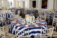 navy and white stripe table, striped linens table, nautical wedding, nautical table reception, pink and blue wedding, blue and yellow wedding, low centerpiece, nautical centerpiece, beach wedding, yellow centerpiece, pink napkins, reception-table-centerpiece-The-oaks-waterfront-wedding-ashley-michelle-photography-123a