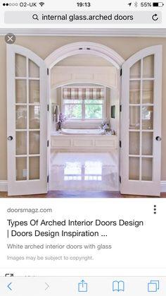 Internal glass archway doors