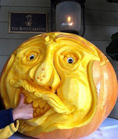 pumpkin carving...these are absolutely amazing, Kaitlin please try to do this for me ;)