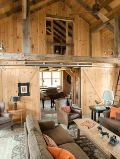 With high ceilings, open beams, and a peekaboo loft this living room oozes quintessential farmhouse charm. Gillian Barth, assistant editor and assistant to the editor | Photo: John Gruen | thisoldhouse.com