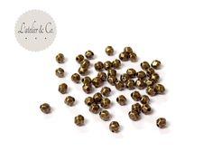 fr_100_perles_a_facettes_4x3_5mm_metal_bronze_bijoux_perles_intercalaires_