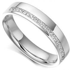 GHP005 - Princess Half Eternity with offset channel. A Princess cut diamond eternity ring with off-set channel