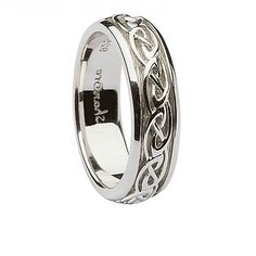 Two people, one life. Our striking sterling silver ladies' Celtic link knot ring symbolizes both your individuality and your interconnectedness with simple pattern of knots. Spanning the center channel of the band, the Celtic link knots feature a slightly diamond-shaped design paired with an endlessly interwoven pattern. This unique Celtic motif is particularly popular for fiercely independent partners who find strength in their unified relationship. This band is available as a matched set…