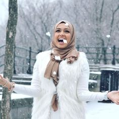 white-fur-vest-with-tan-hijab