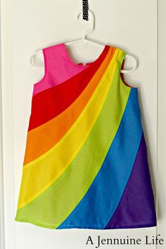 How to make a pieced rainbow dress.  Tutorial shows a little girl's dress but the process is the same for an adult.