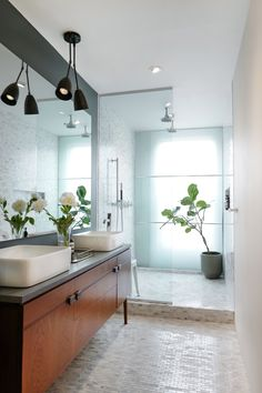The couple custom designed many things in the bathroom. The planter is Modernica, however.