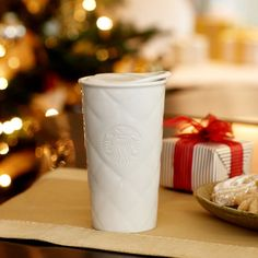 Remember when Starbucks had those faux knitted/sweater mugs in white ceramic?  I should have bought one of those.  This is the next best thing: Starbucks® Double Wall Ceramic Traveler - Quilt, 12 fl oz. $14.95 at StarbucksStore.com