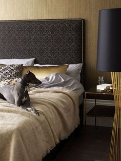 this headboard is so intricate and beatiful; love the gold pins against the dark fabric