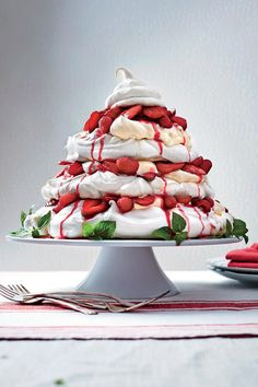 Red Berry Pavlova Tower - 19 Valentine's Desserts That Have Us Seeing Red - Southernliving. Recipe: Red Berry Pavlova Tower  If you are hosting a Valentine's Day party, serve this meringue tower and you will definitely be everyone's sweetheart.