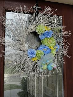 spring wreath...have the wreath---just need to spray it the right colour---maybe do it more like a peacock but good inspiration