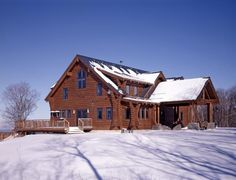 Log home in winter with concave corners