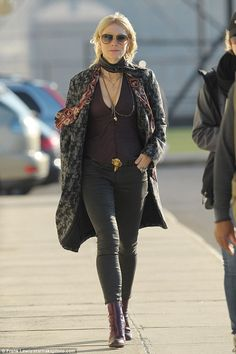 Her look du jour:The star also had on a longer maroon scarf and the same grey and black c...