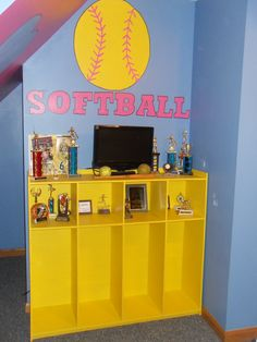 We had this wooden locker built to hold some of her softball awards and my daughter painted it yellow. The bottom sections has locker hooks that aren't shown in this picture. It also serves as her TV stand. Softball Decorations, Softball Crafts, Softball Mom, Girls Softball Room, My New Room, My Room, Girl Room, Bedroom Themes, Girls Bedroom