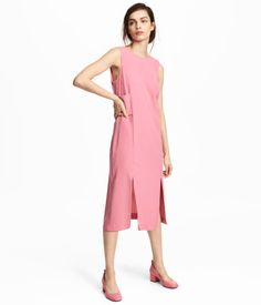 Pink. Sleeveless, knee-length dress in textured-weave fabric. Low-cut V-neck at back, concealed zip, and wide, decorative band at waist. Two slits at front