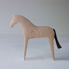 Horse, Maplewood  The tender curve to be carved had produced the beautiful wood pattern.
