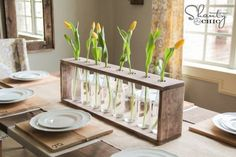 Wanting to just use a bottle with a tulip for center pieces for the wedding. Embellish a little, will be cute!