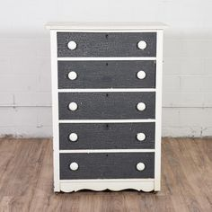 This tall shabby chic dresser is featured in a solid wood painted in a white with navy blue crackled paint details. This nautical inspired dresser is in great condition with 5 drawers and a curved base trim. Perfect dresser for a kid's room!   #dressers #talldresser #sandiegovintage #vintagefurniture