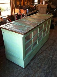 Kitchen island made from old doors, I would seal the top and fit a custom made butcher wood on top.