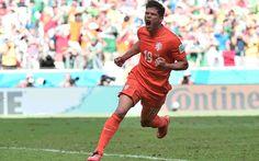Klaas-Jan Huntelaar celebrates scoring the winning penalty in stoppage-time.
