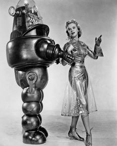 Robby the Robot and Anne Francis. Forbidden Planet. #film #movies #scifi   Great Helen Rose Costumes!